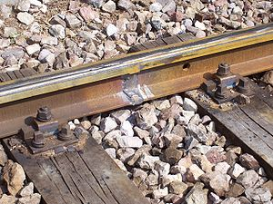Railroad tie - A variant fastening of rails to wooden ties
