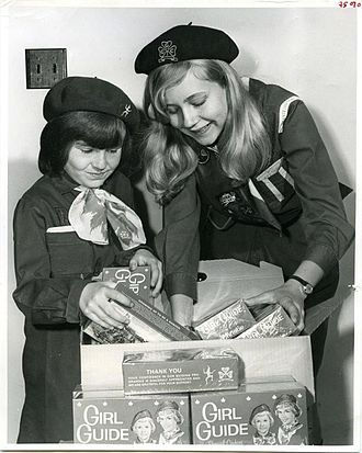 Girl Guides of Canada - Girl guides in 1969 with cookie boxes to sell
