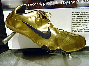 English: Golden shoes Michael Johnson Nike tow...