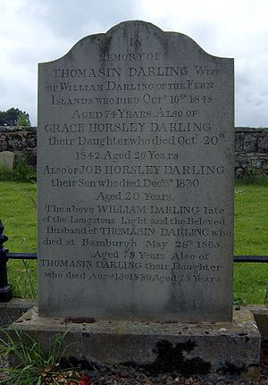 Grace Darling - Grave of Grace Darling and her family, St Aidan's churchyard, Bamburgh. This is a replica headstone made to replace the weathered original, now in the nearby RNLI museum.