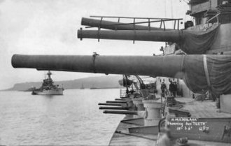 HMS Malaya - 15-inch guns of 'A' and 'B' turrets trained to starboard, 6-inch guns in casemates below, c. 1920
