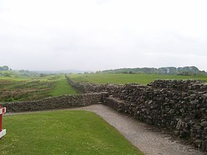 Cohors I Aelia Dacorum - View of the remains of Hadrian's Wall (right, stretching into the distance), as seen from Fort Banna. Originally, the wall was c. 5 m (16 ft) high, but stone removal over the centuries has reduced its remains, at this point, to barely 2 m