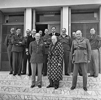 "Henry Maitland Wilson - Wilson with Churchill and Eisenhower in Italy, 25 December 1943. Churchill was recovering from pneumonia. ""Jumbo"" Wilson's bulk is obvious."