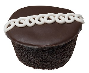 "Cupcake - A mass-produced Hostess CupCake, a typical ""snack cake"" style of cupcake"
