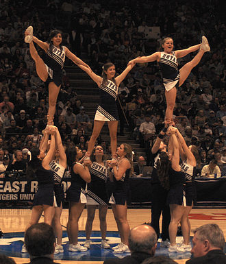 2006–07 Georgetown Hoyas men's basketball team - Georgetown cheerleaders perform at the IZOD Center in East Rutherford, New Jersey, during the Hoyas′ NCAA Tournament game against North Carolina on March 25, 2007.
