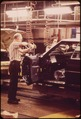 INSTALLING BODY WIRING ON THE CADILLAC ASSEMBLY LINE - NARA - 549719.tif
