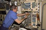 ISS-12 Bill McArthur at the galley in Zvezda Service Module.jpg