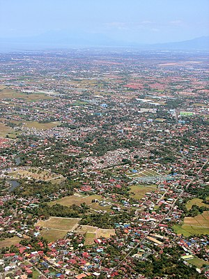 Imus - Aerial view of Imus. Located on center right is Nueno Avenue, with the Cathedral and belfry (also on center right). In the foreground is Medicion I St. that leads to Binakayan, Kawit.