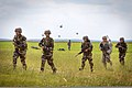 Indian Army soldiers with the 2nd Battalion, 5th Royal Gurkha Rifles and U.S. Army paratroopers with the 1st Brigade Combat Team, 82nd Airborne Division move toward their objective after being dropped off 130511-A-DK678-018.jpg