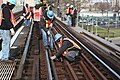 Installing plates and rails on F line (11294150244).jpg