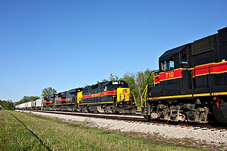Iowa Interstate Railroad - Two trains meet near Altoona, Iowa. At left, train 707 is led by a GP 38-2. At right, train 710 is also led by a GP 38-2.