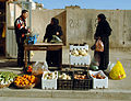 Iraqi women purchase produce from a market stand in Baghdad, Iraq.jpg