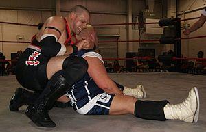 Mikhail Ivanov (wrestler) - Ivanov with a rear chinlock on Phi Delta Slam's Bruno Sassi