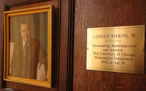J. Ernest Wilkins Jr. - Wilkins portrait and plaque honoring him in the Eckhart Hall Tea Room of the Physical Sciences Division, University of Chicago in 2007. (Courtesy: Dan Dry)
