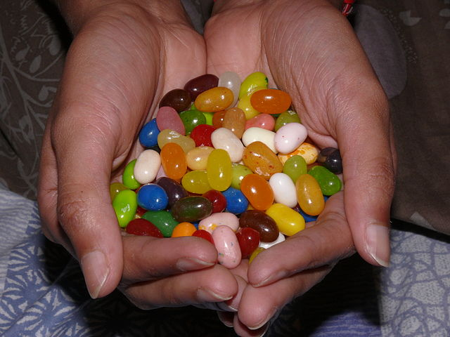 Hands holding jellybeans