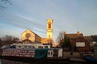 Jericho, Oxford - Boaters protest against the proposed sale of the Castle Mill Boatyard on the Oxford Canal, 2005, with St Barnabas Church in the background.