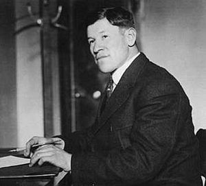 A young Jim Thorpe at a desk.