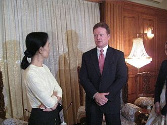 Aung San Suu Kyi - US Senator Jim Webb visiting Aung San Suu Kyi in 2009. Webb negotiated the release of John Yettaw, the man who trespassed in Suu Kyi's home, resulting in her arrest and conviction with three years' hard labour.