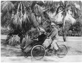 Joe Jefferson (on seat on front of quadricycle being peddled by another man), Palm Beach, Fla. LCCN2002699812.tif