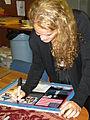 Julie Payette, Canadian astronaut, signs an autograph.jpg