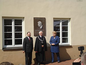 Justinas Marcinkevičius - During the ceremony of the opening of the memorial plaque with Dalia Grybauskaitė in the Vilnius University Sarbevijus' courtyard.