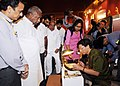 Kavuru Sambasiva Rao going round the exhibition at the International Seminar for Promotion of Exports of Indian Handicrafts & International Craft Exchange Programme, in New Delhi on September 18, 2013.jpg