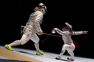 Sabre (fencing) - Kim Ji-yeon (R) attacks Mariel Zagunis (L) with a lunge in the 2014 Orléans World Cup