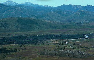 King River (Tasmania) - King River near Mount Huxley in the 1970s prior to damming. Frenchmans Cap is located in upper right corner of the photo.
