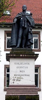 """Statue of William IV in Göttingen, Germany. The Latin inscription reads: """"William the Fourth, King, Father of the Fatherland"""". (Source: Wikimedia)"""