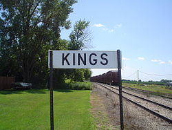 Sign along the railroad tracks for Kings