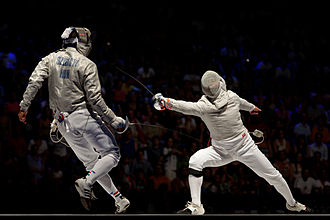 Áron Szilágyi - Szilágyi (L) evades Kovalev's attack in the semi-finals of the 2013 World Fencing Championships