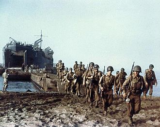 36th Infantry Division (United States) - A U.S. Navy Landing Ship-Tank (LST-1) landing American Army troops --possibly from the 36th Division-- on an Italian beach, via a causeway.  Note: This photograph is believed to have been taken during the Salerno landings in September 1943..