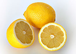Lemon, whole and in section