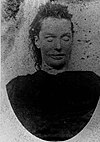 Mortuary photograph of Stride: a woman with angular features and a wide mouth