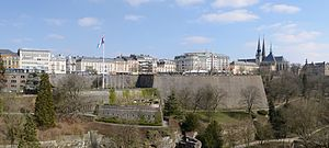 Luxembourg - View to Place de la Constitution and Gëlle Fra monument, from the capital's Metz square at the Adolphe Bridge end of Avenue de la Liberté, connecting with the railway station