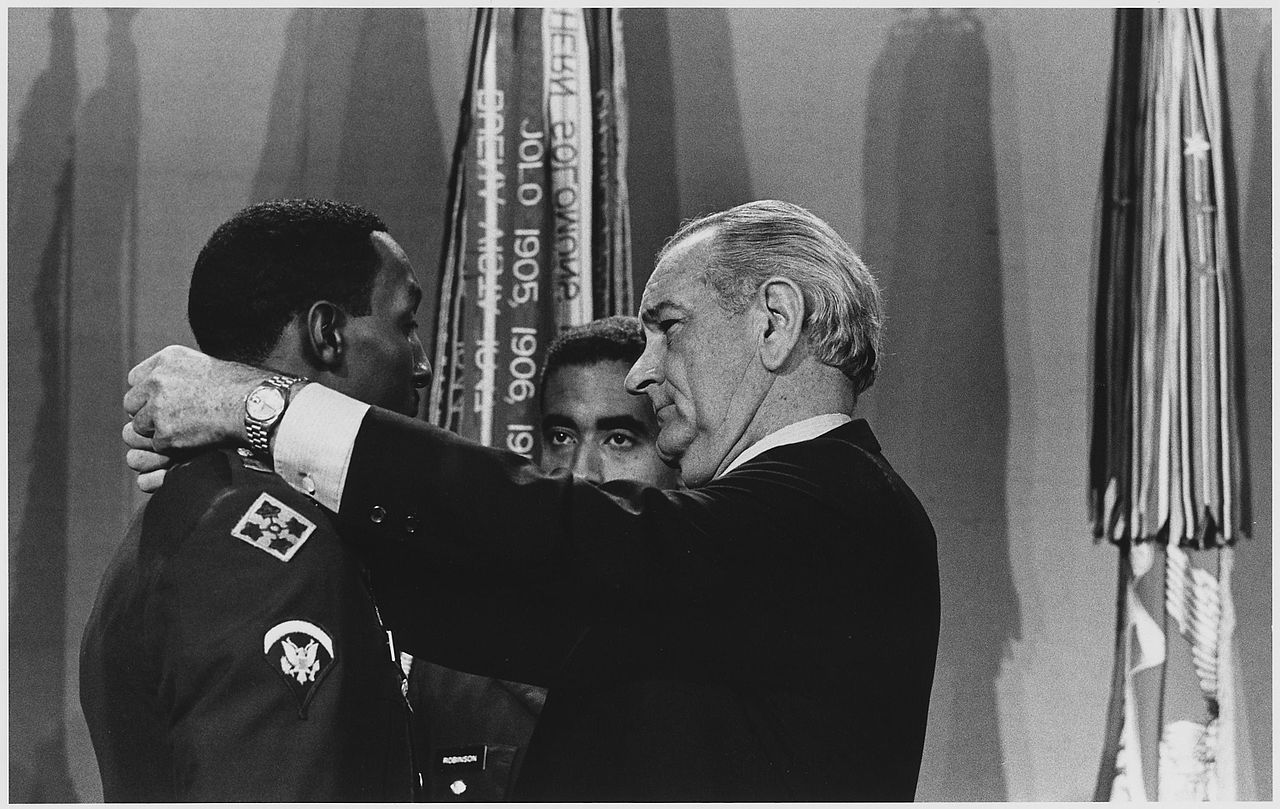 Photo of Dwight Johnson receiving the Congressional Medal of Honor from President Johnson, courtesy of Wikipedia