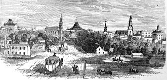 Wisconsin State Capitol - View of downtown and the old capitol from Washington Street, 1865.