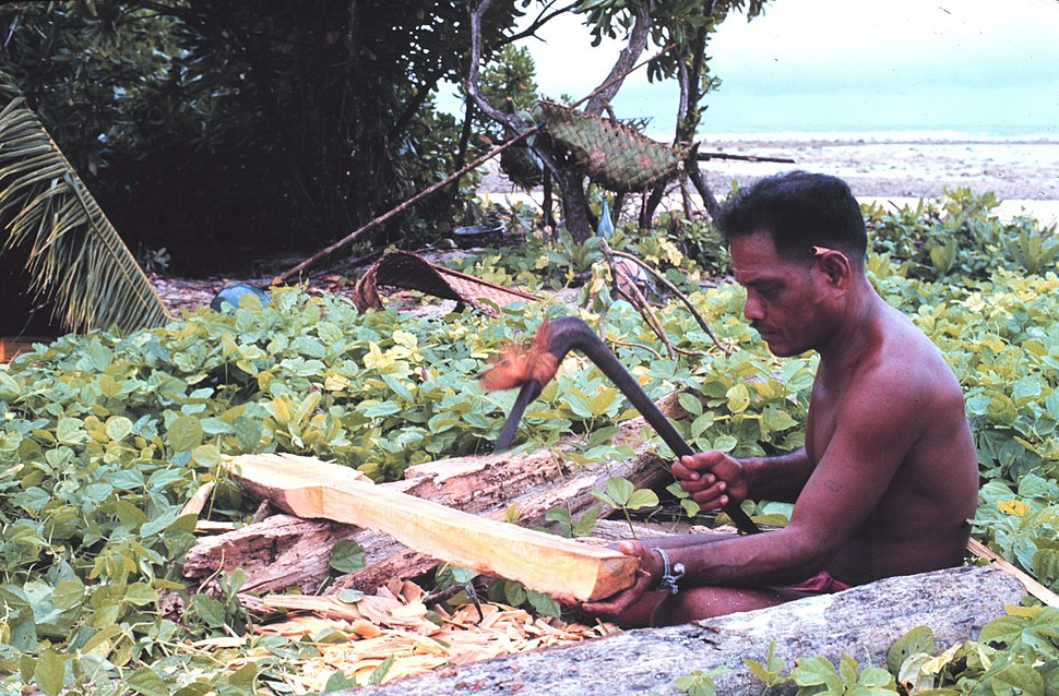 Making paddle with adze, Tobi, Western Caroline Islands, Micronesia