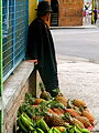 Man on street with pineapples.jpg