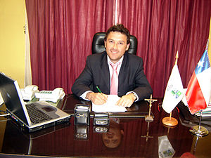 Flag of Pichilemu - Marcelo Cabrera, mayor of Pichilemu, in his office. The flag of Pichilemu can be seen on his table.