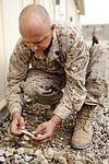 Marine leaves 'no rock unturned' creating deployment art 131124-M-ZB219-019.jpg