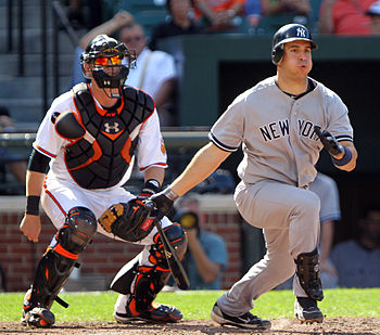 Mark Teixeira swings at a pitch during a game ...