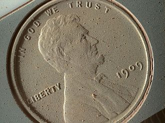 Victor David Brenner - 1909 VDB penny on Mars, covered in Martian dust despite its vertical mounting position.