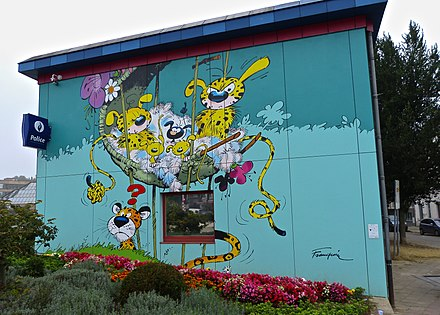 A wall painting in Brussels, Belgium, depicting the Marsupilami family from Le nid des Marsupilamis