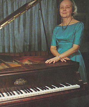 Martha Goldstein - Goldstein standing behind an 1851 Erard piano