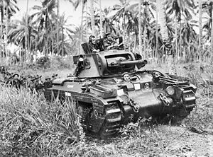 Jungle division - A Matilda tank from the Australian 4th Armoured Brigade, moves towards Japanese strong points near Finschhafen, on 9 November 1943.