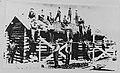Members working on Pioneer Shack in 1923 on Stampede fairgrounds.jpg