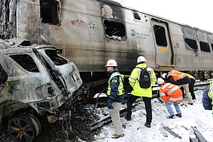 Valhalla train crash - NTSB investigators survey the vehicles involved in the accident