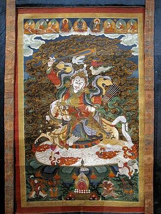 Buddhism in Mongolia - Thangka showing a mountain deity carrying a sword