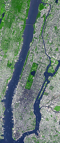Central Park is visible in the center of this satellite image. Manhattan is bounded by the Hudson River to the west and East River to the east.